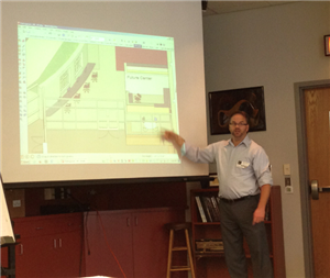 Senior Project Manager, Jim Keiffer, reviews building plans with teachers